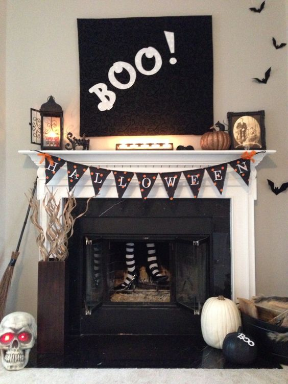 put faux witch's legs into a fireplace to make it scarier