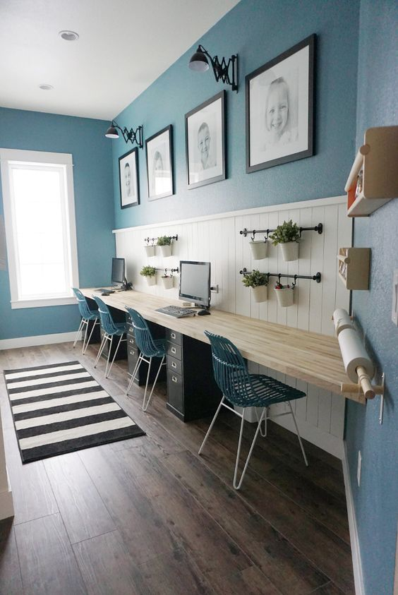 such a comfy shared study space can accomodate up to four people thanks to a wall-mounted desk