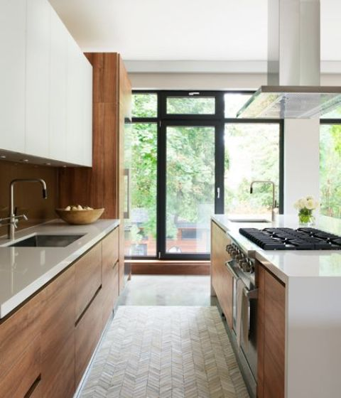 warm-colored wood modern kitchen with white cabinets and countertops looks chic