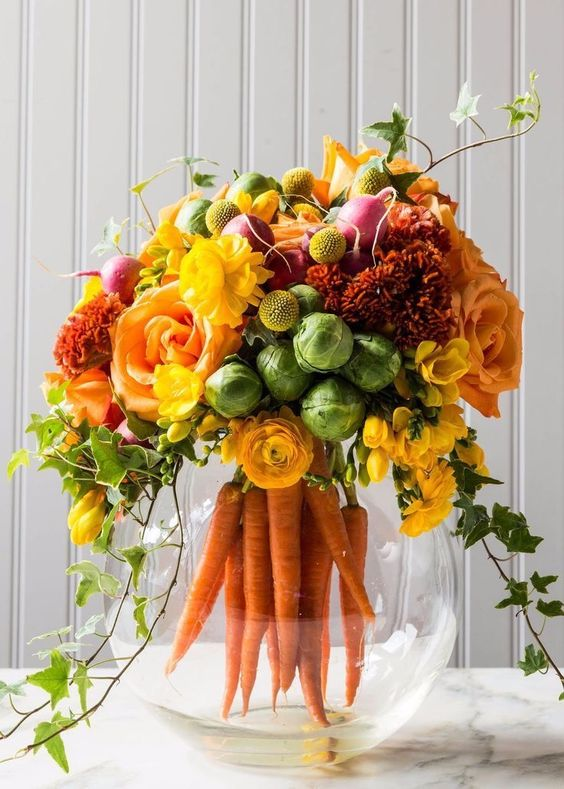 yellow, orange and burnt orange blooms, billy balls, carrots, foliage and brussels sprouts