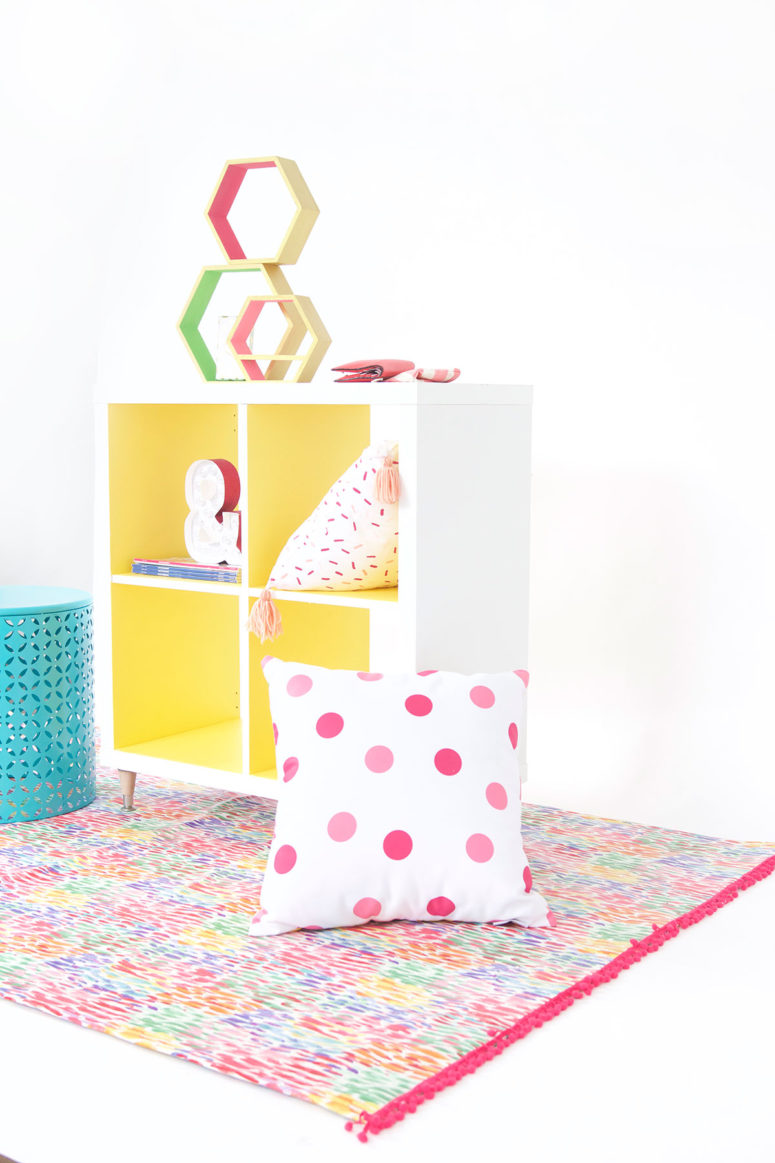 DIY Kallax hack with new legs and bold yellow paint (via damasklove.com)