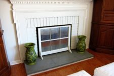 DIY window sash fireplace screen