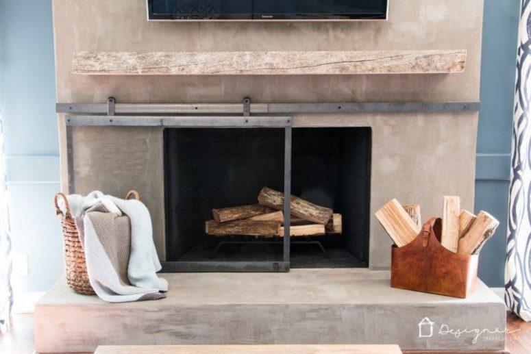 DIY metal barn door fireplace screen (via www.designertrapped.com)