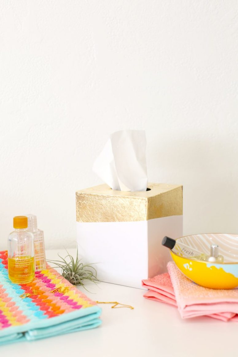 DIY gold leaf tissue holder (via lovelyindeed.com)