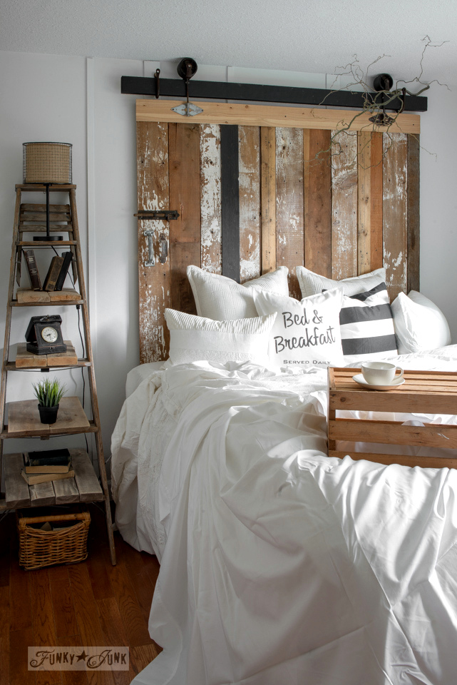 DIY barn door headboard with faux hardware (via www.funkyjunkinteriors.net)