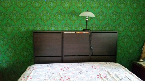 DIY headboard of Bissa shoe cabinets (via www.ikeahackers.net)