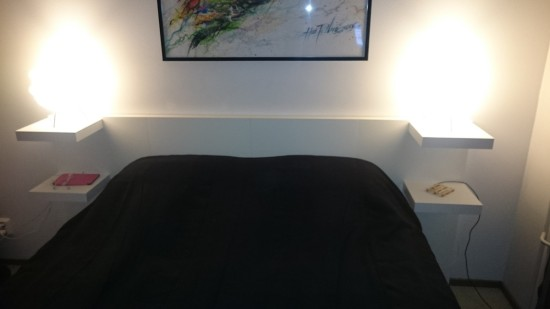 DIY headboard from Lack tables and shelves (via www.ikeahackers.net)