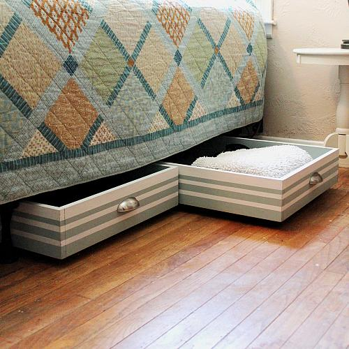 DIY rolling underbed drawers covered with wallpaper (via decoart.com)