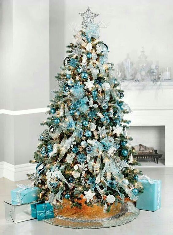 a Christmas tree with turquouise ornaments, garlands and silver balls