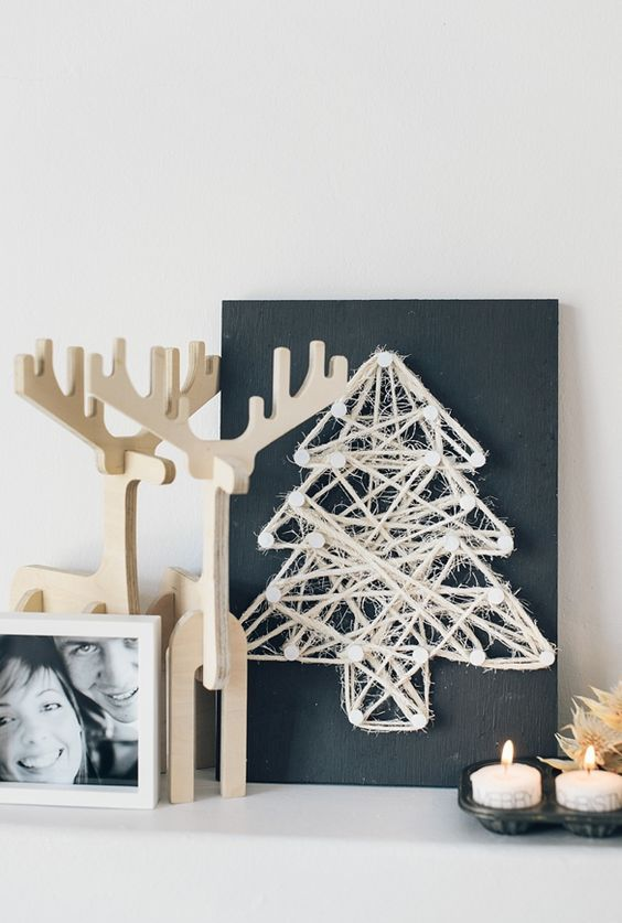 a chalkboard sign with a twine Christmas tree art for a minimalist space