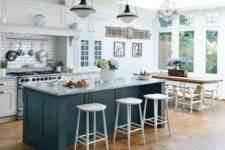 02 a chic emerald kitchen island with a marble countertop and a breakfast zone on one side