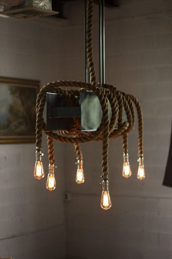 a metal beam, rope and bulb chandelier looks rather brutal