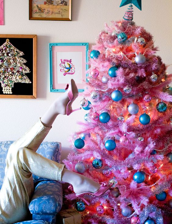 a pink Christmas tree with silver and blue ornaments for a fun touch