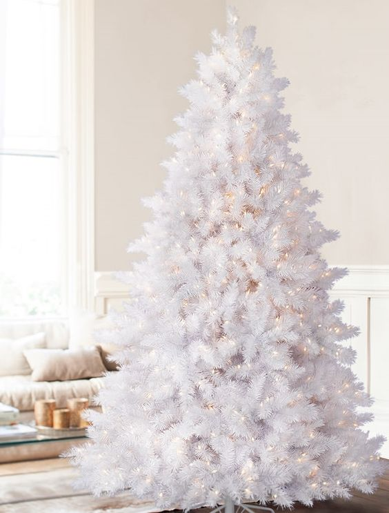 a white pre-lit Christmas tree doesn't require decor, it's cool and bold and you can leave it like that