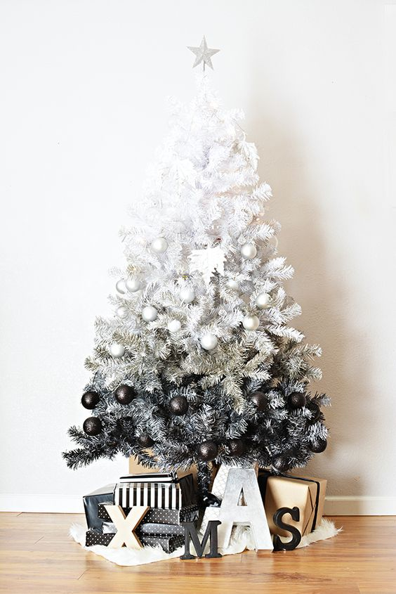 an ombre white to black ombre Christmas tree with black and white ornaments