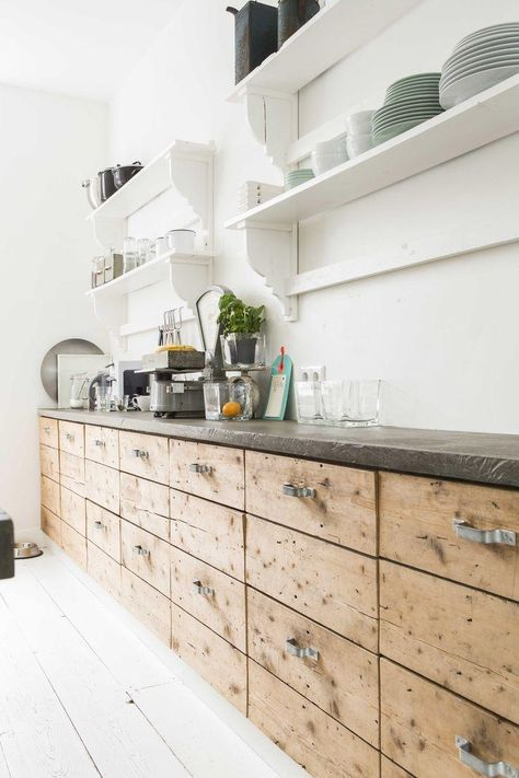 chic wooden cabinets with metal handles and stone countertops for an industrial feel