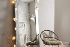 03 a mirror in a reclaimed frame with a light garland on it will make it cuter