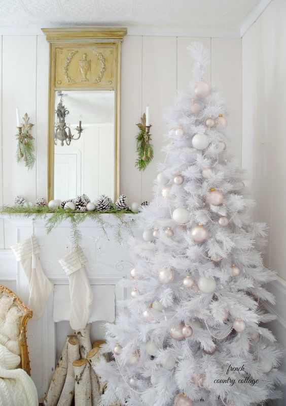 a white Christmas tree with pearly and blush ornaments and some pearl strands for a vintage chic touch