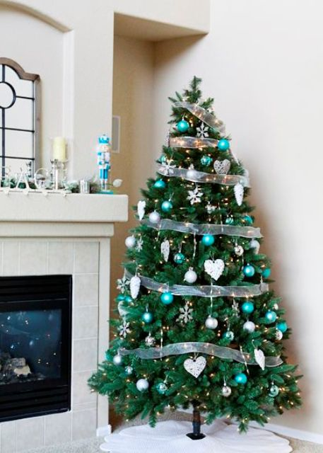 mix turquoise ornaments with silver ones for an elegant color scheme - Turquoise Christmas Tree Decorations
