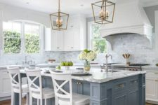 04 a coastal pale blue kitchen island with a breakfast space and white stools