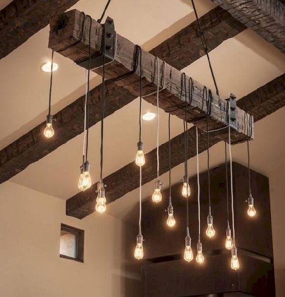 a reclaimed wooden beam with metal detailing and bulbs hanging on cords for a masculine space