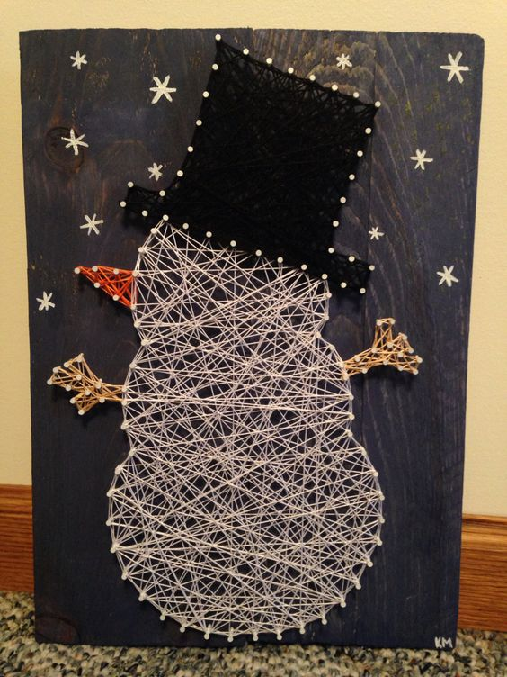 a snowman string art will excit both kids and adults