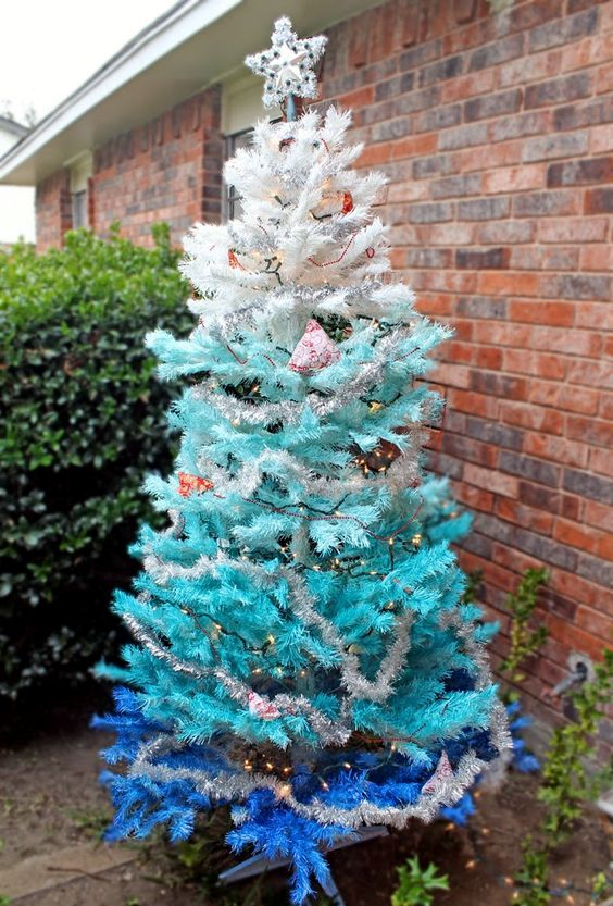 ombre spray painted Christmas tree from white to bold blue with lights