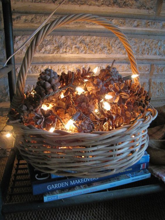 a basket filled with pinecones and LED lights for a cozy feel in your home