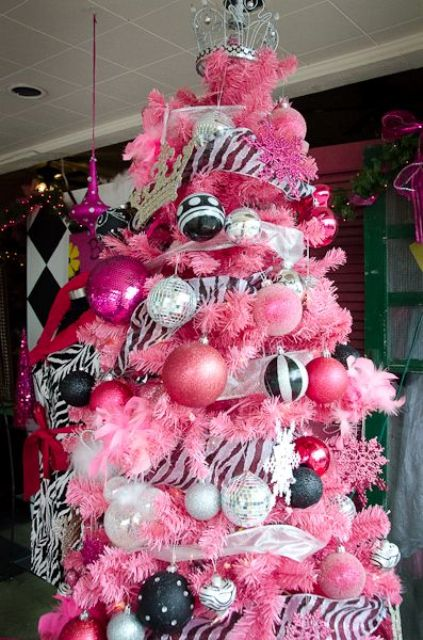 a bold pink tree with white, black and pink ornaments and bold garlands