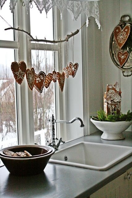 glazed heart-shaped gingerbread cookies hanging on a branch on the window
