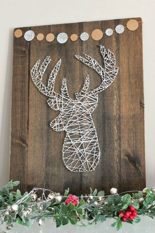 a deer head string art done in white will fit lots of spaces