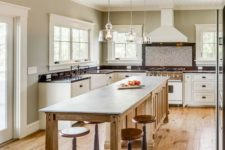 06 a long rustic kitchen island with a dining zone and vintage stools