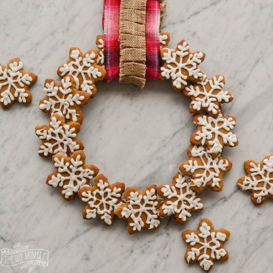 an edible wreath of iced gingerbread cookies shaped as snowflakes can be used for decor, too