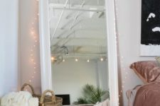 06 decorate your floor mirror with lights to accentuate it even more