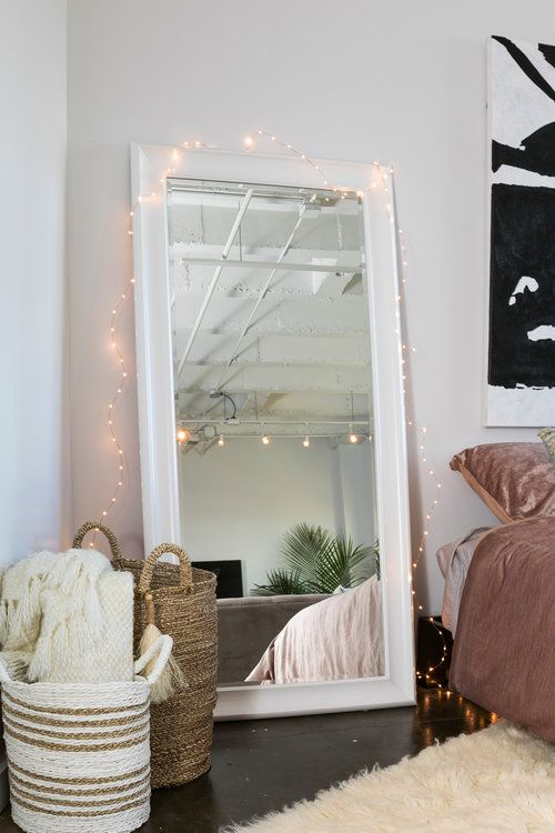 decorate your floor mirror with lights to accentuate it even more