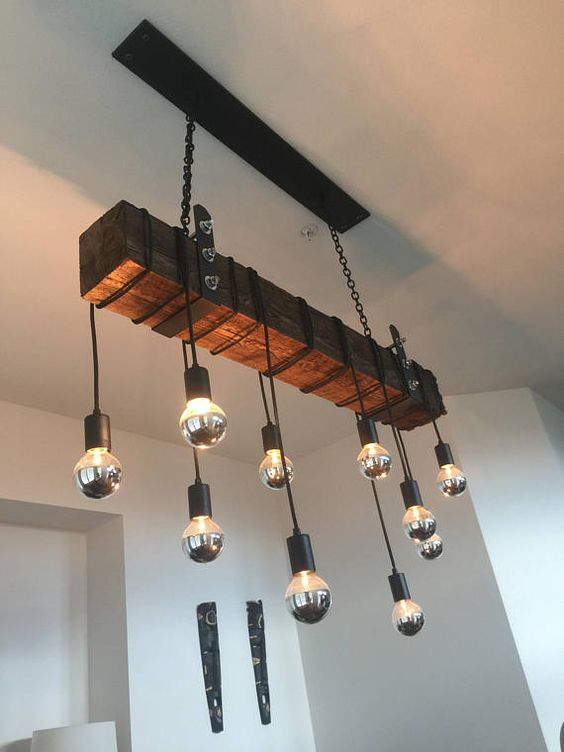 rustic industrial multi pendant bulb chandelier with chain and a wooden beam