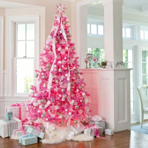 a bold pink Christmas tree with silverm white and metallic ornaments