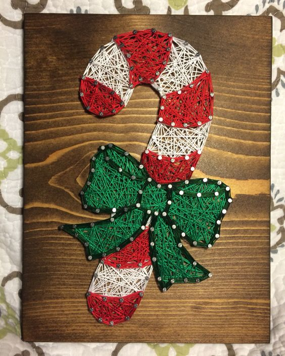 a candy can Christmas string art in red, green and white
