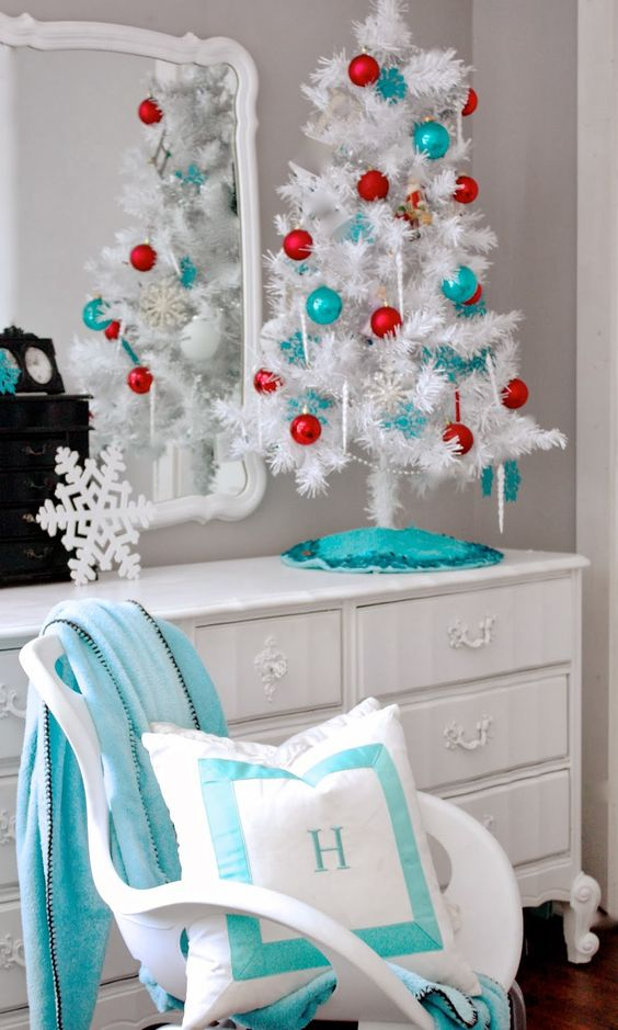 a white tree with red and turquoise ornaments - a very bold duo