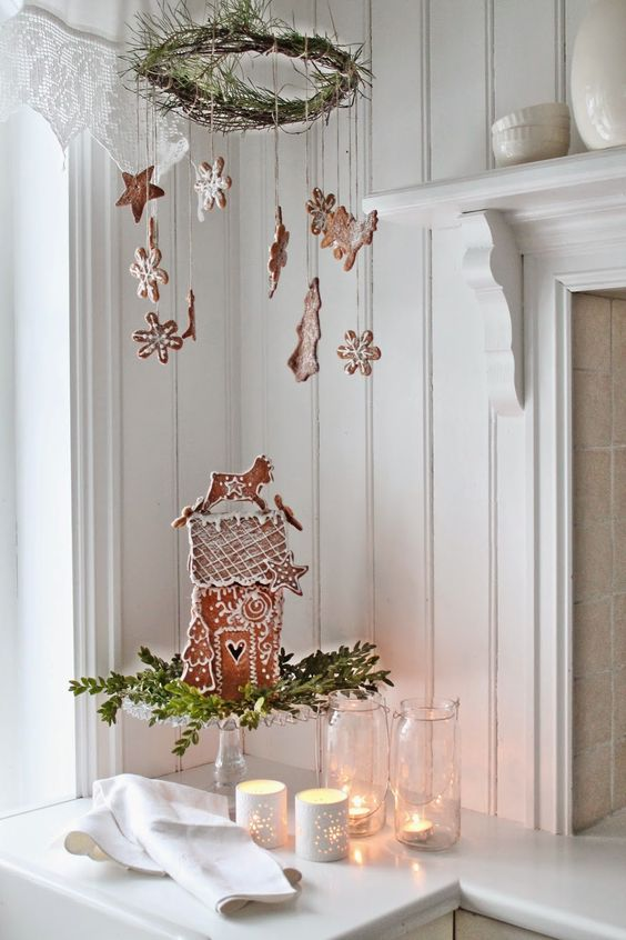 a wreath with hung gingerbread cookies for a cool and cute decoration
