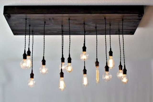 an industrial rustic chandelier of reclaimed wood and different bulbs will fit many industrial spaces