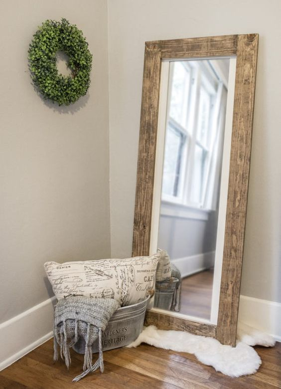 if your bedroom is rustic, why not choose a mirror in a reclaimed wooden frame