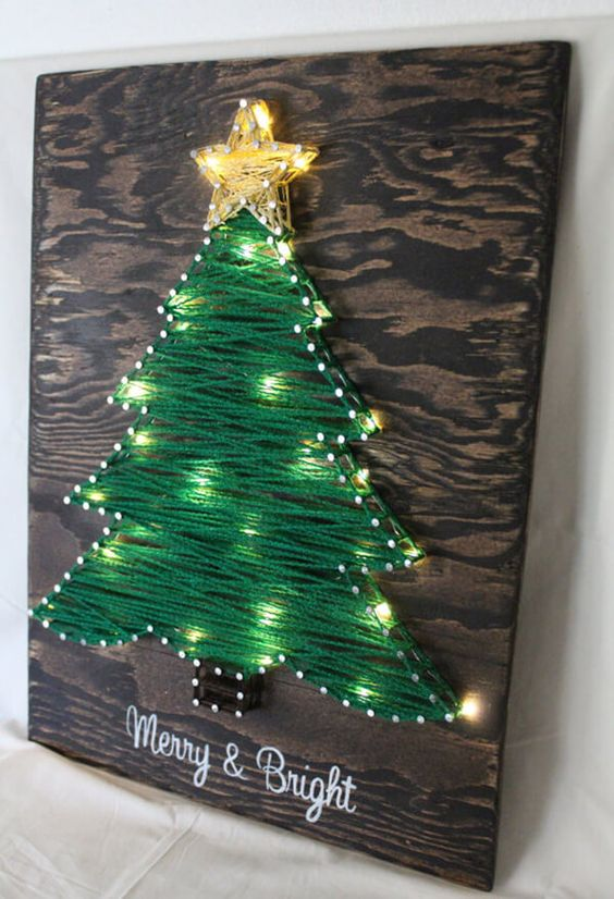 a Christmas tree sign in green with additional lights looks very festive and cute