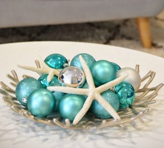 a coastal Christmas display with turquoise ornaments and star fish