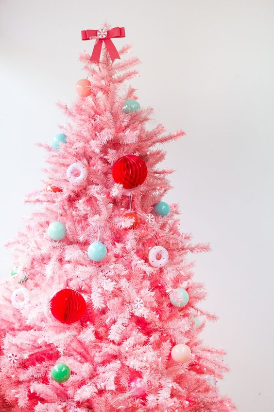 a pink tree with donut ornaments, honeycombs and mint ornaments