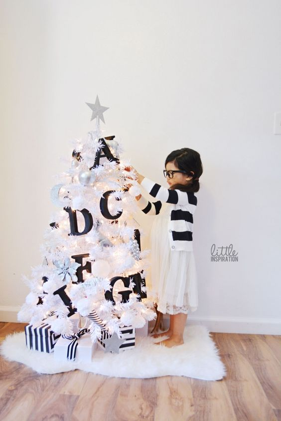 a white tree decorated with black letters will help your kid to learn them faster