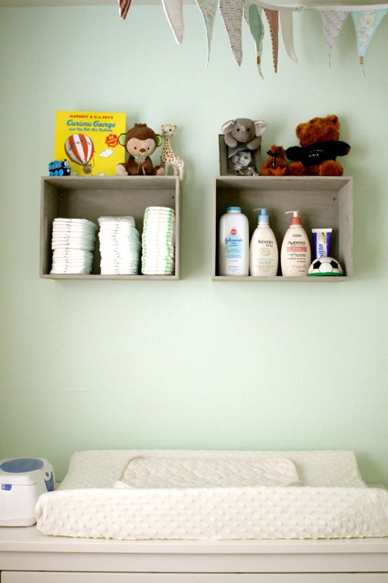 attach box shelves over the changing table and store there everything necessary