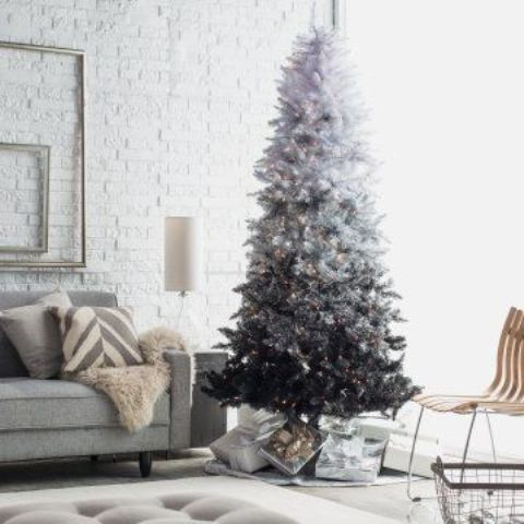 vintage-inspired white to black Christmas tree with lights looks very chic