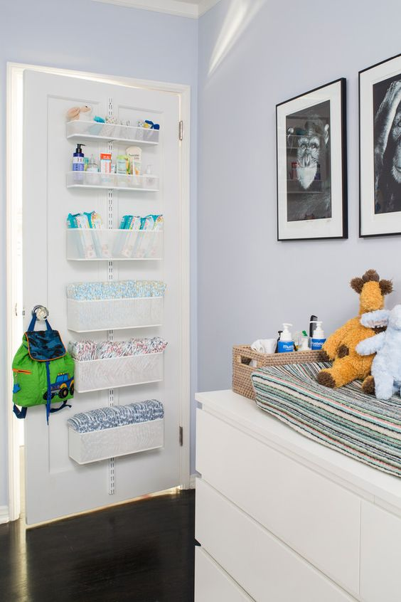 attach some box shelves right on the door next to the changing table