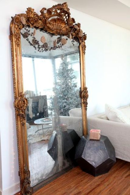 make a statement with an oversized vintage mirror in an exquisite frame